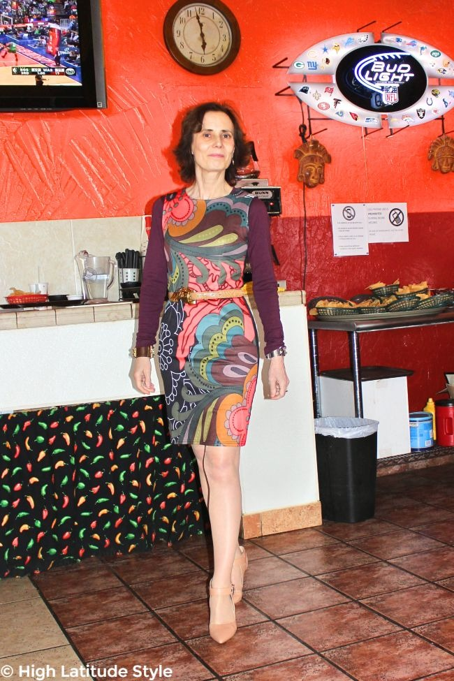 #maturefashion woman in crazy print sheath for work with T-shirt layered underneath