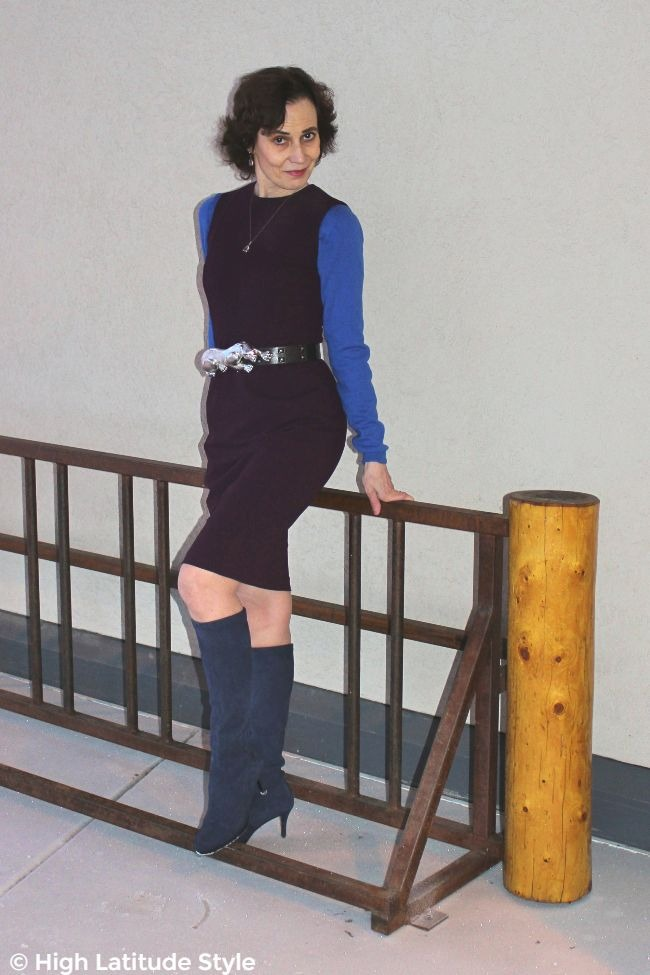 mature style book author in tailored dress with blue sweater and boots
