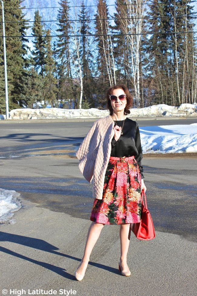 #midlifestyle woman in posh spring look with sunglasses, jacket, skirt, shirt, and pumps