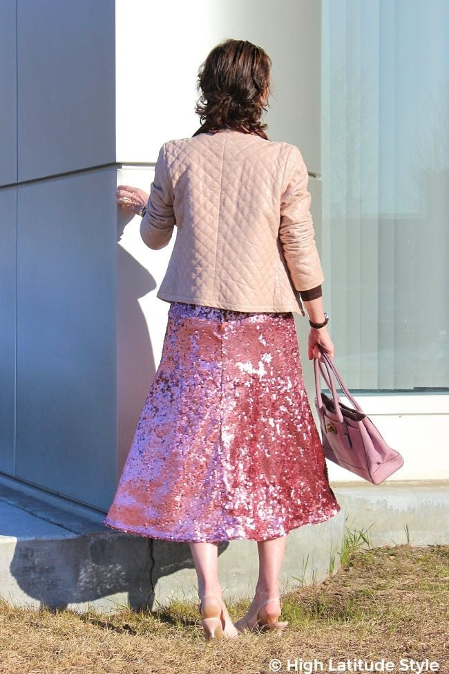 #advancedstyle woman wearing a sequin skirt and leather jacket in spring
