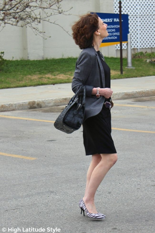 #styleover50 women indesaturated work outfit with gray jacket, black T-shirt dress