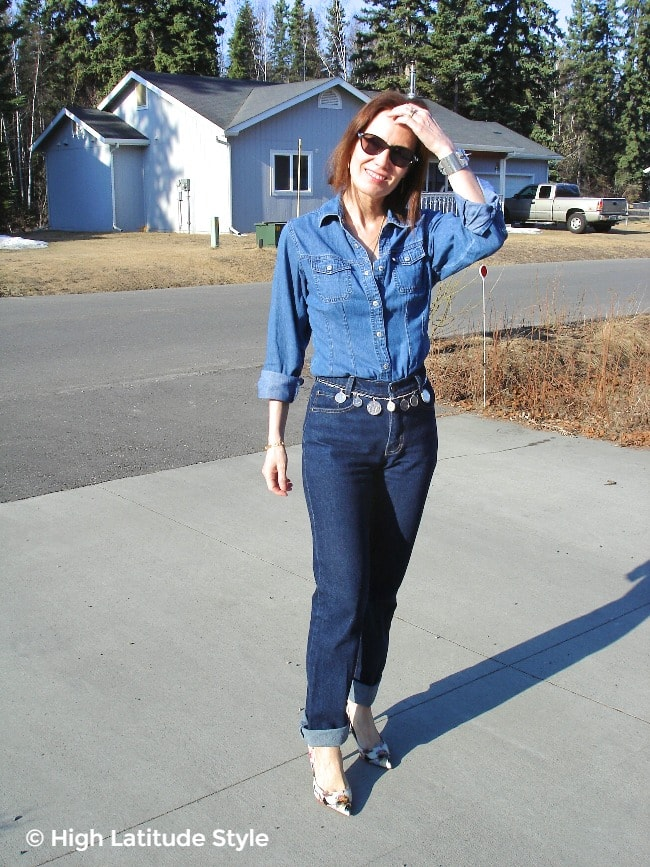 midlife woman in double denim with high waist jeans and denim shirt