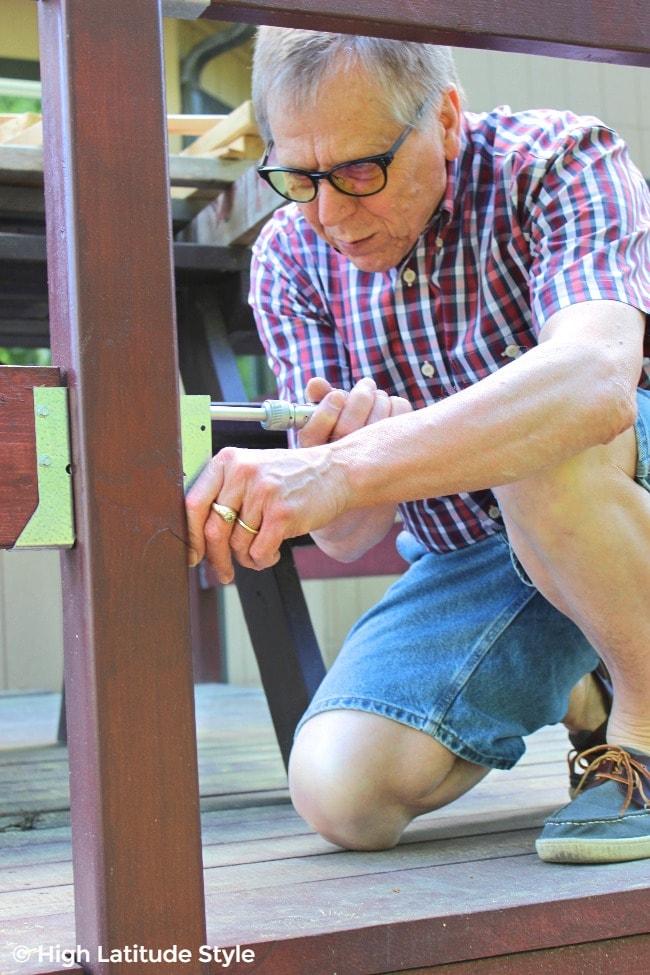 #eyewear mature guy working on a deck with protective eyewear c/o Gunnar
