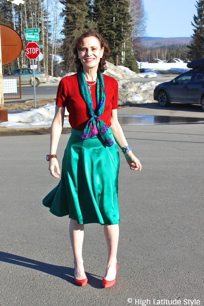 #fashionover50 midlife woman looking posh in a knitted silk top and silk skirt office outfit