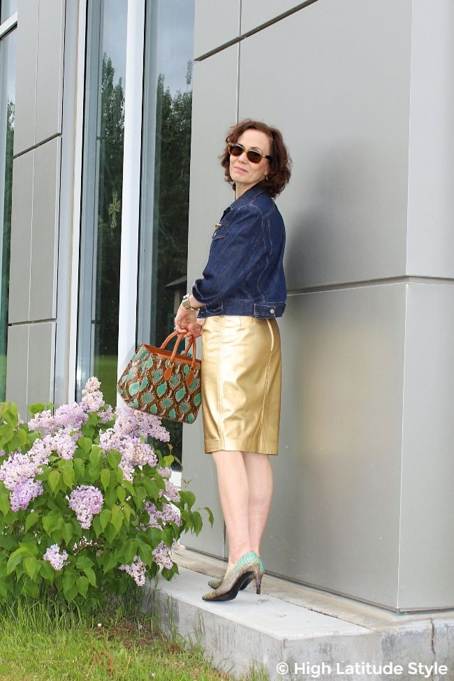 older woman in golden leather skirt with denim jacket