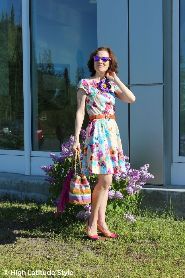 style blogger over 40 in colorful outfit with stripes and floral print