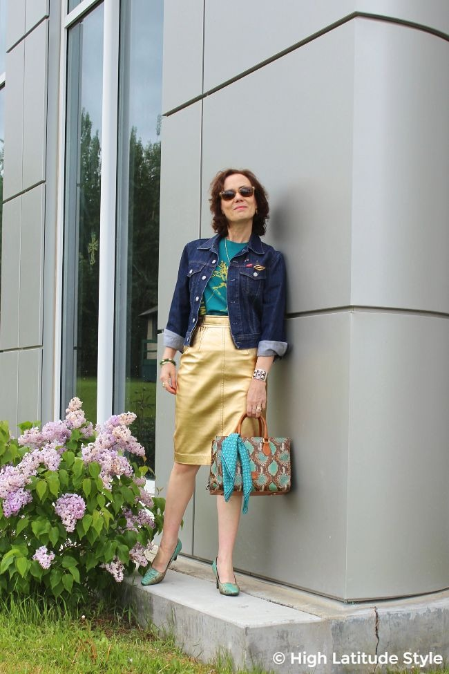 #advancedstyle midlife woman in golden leather skirt, Tee and denim jacket