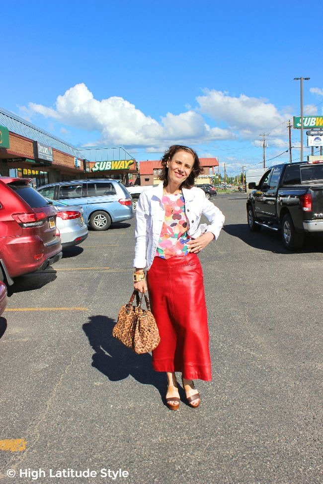 #fashionover50 mature woman in in maxi leather skirt, Fossile jacket, printed top and MK satchel
