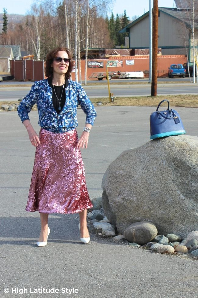 midlife woman in street chic look of sequins with silk and high patent leather heels