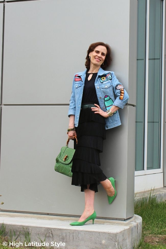 #fashionover50 mature woman in street style outfit with sequins, pleats, denim and black