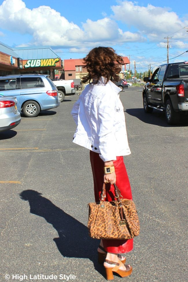 #onlineshopping #advancedstyle #MK woman in white jacket and red leather skirt with leopard print satchel