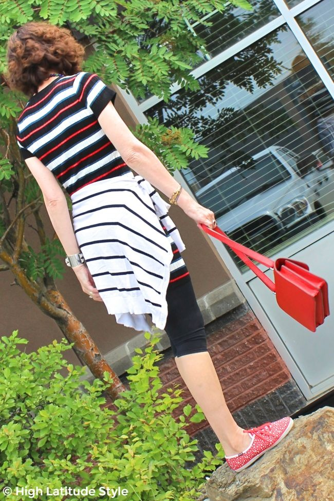 #midlifestyle back view of woman weekend outfit with knit dress, leggings, crossbody and Keds