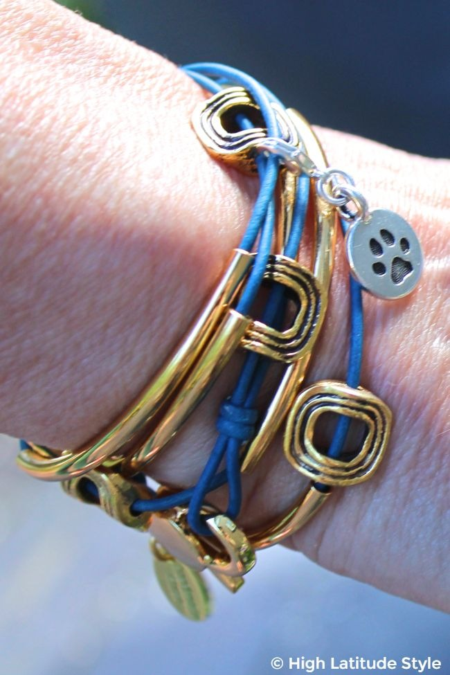 #jewelryover40 wrist of an older woman adored with a band covered with ornaments and tubes