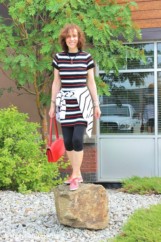 #fashionover50 older lady in black red green white striped dress