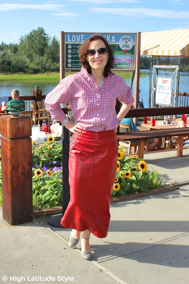 #fashionover50 midlife woman wearing a button down shirt and maxi leather skirt