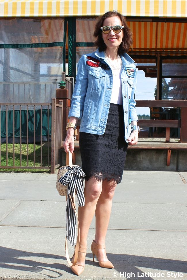 #turningfashionintostyle #advancedstyle midlife woman in oversize sequin embellished denim jacket, lace skirt, pumps, and basket bag