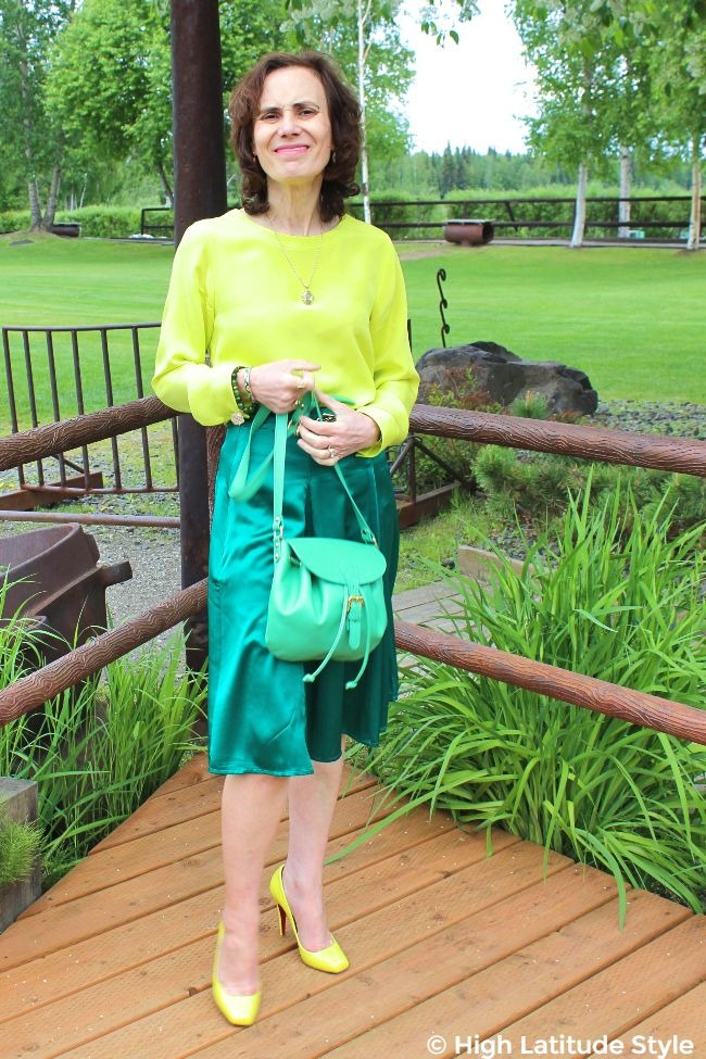 #styleover50 woman wearing a summer office outfit in teal and lemon colors