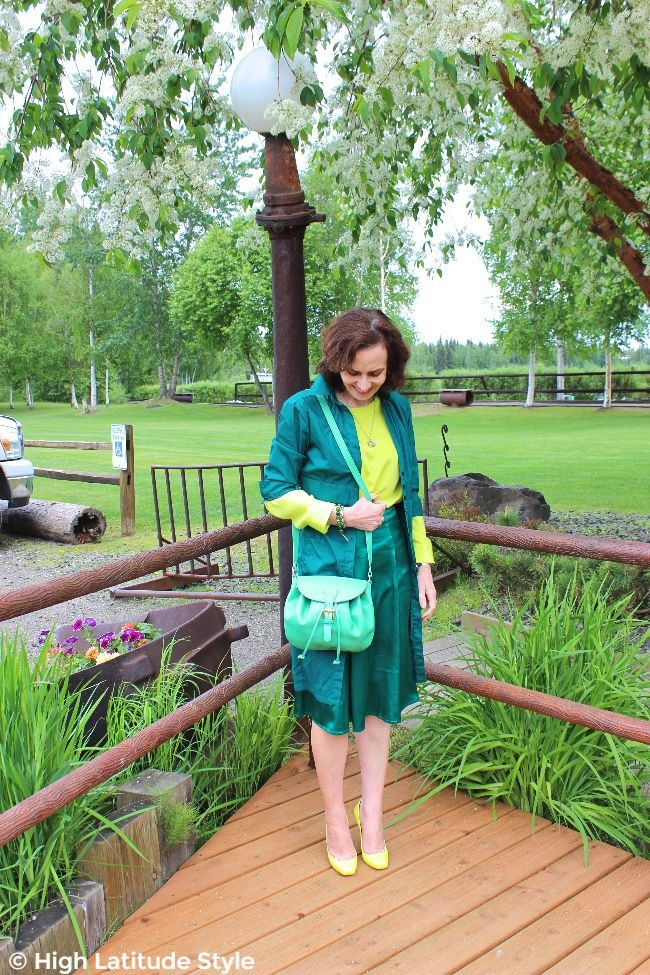 #fashionover50 woman in an outfit of shades of green colors