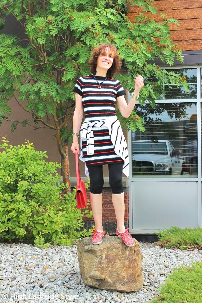 #fashionover50 mature woman in mini dress with leggings, Keds and cardigan knotted around the waist