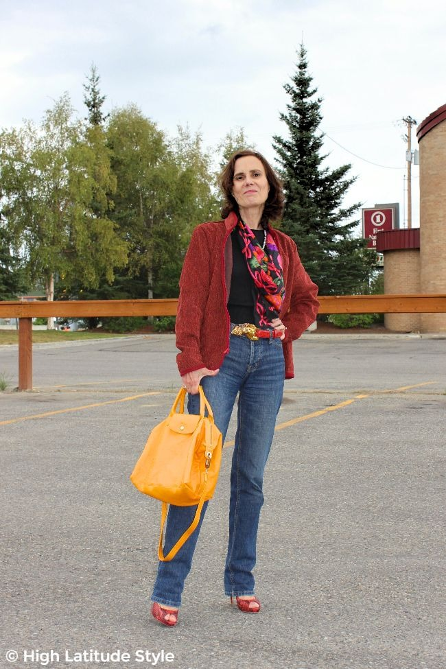 #advancedstyle midlife woman looking casual posj in a #WhistleRiver zipper-jacket, jeans, sweater, scarf and heels