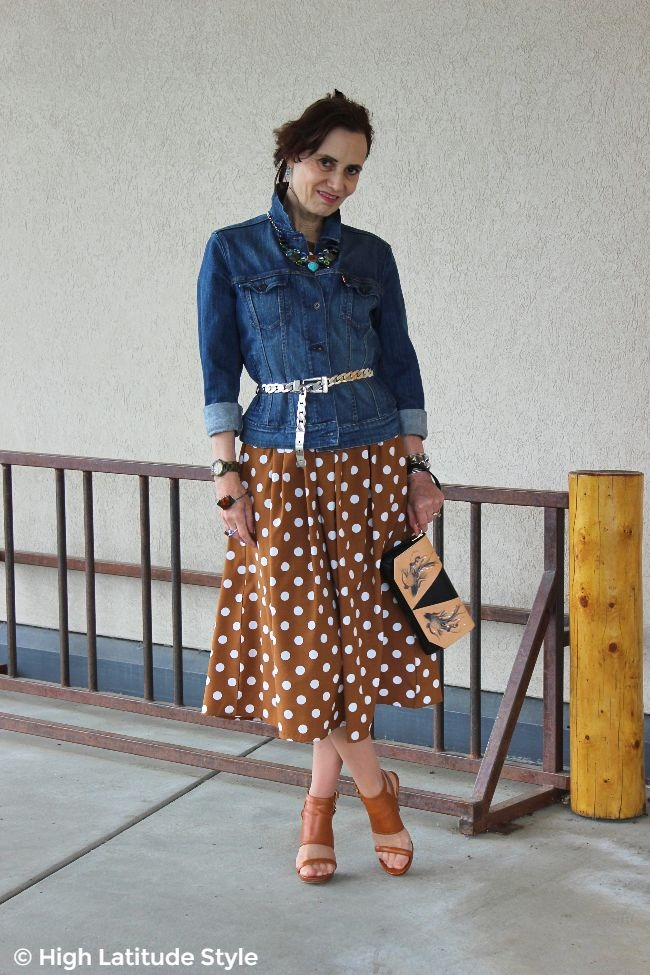 #advancedfashion woman in polka dot dress with denim jacket
