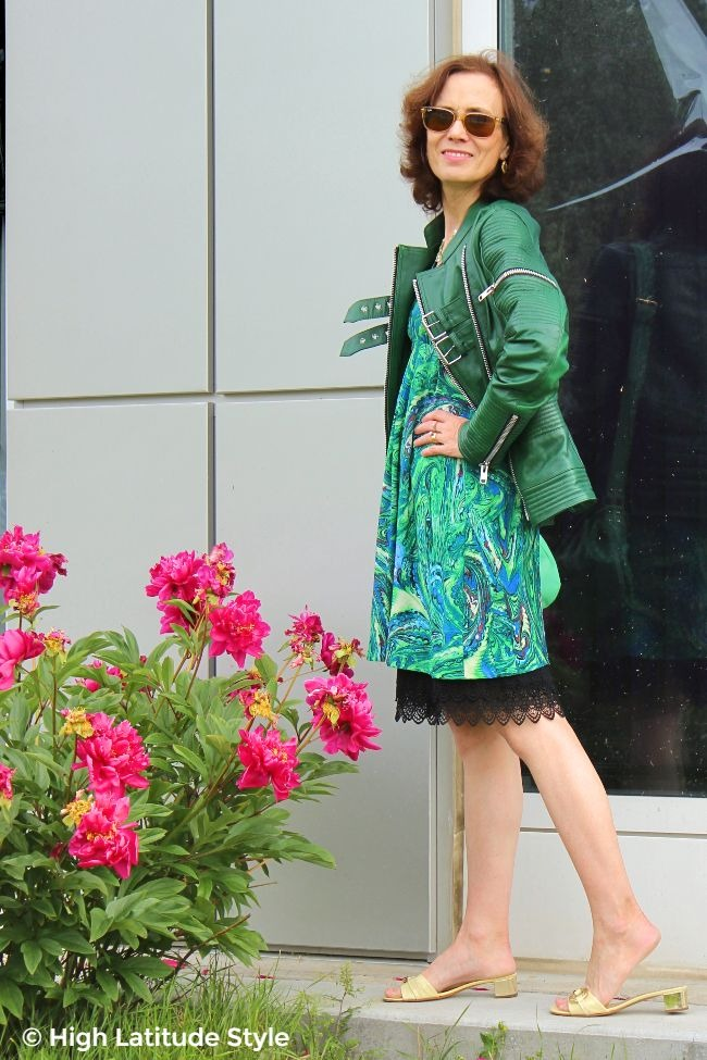 #fashionover50 mature woman standing in front of a school in a green, yellow and black outfit