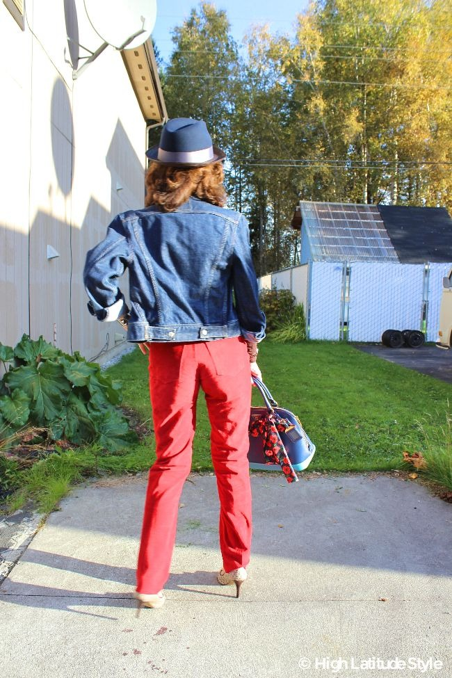 lady in red, brown and blue fall outfit with Santana Katmandu hat
