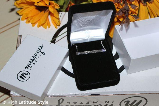 #jewelryover40 #MessagesInMetal presentation of jewelry in a velvet box