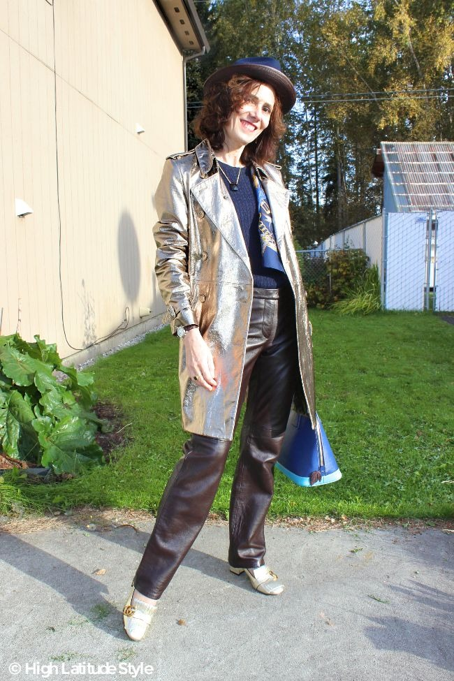 #midlifestyle woman in leather trench coat, leather pants and fedora