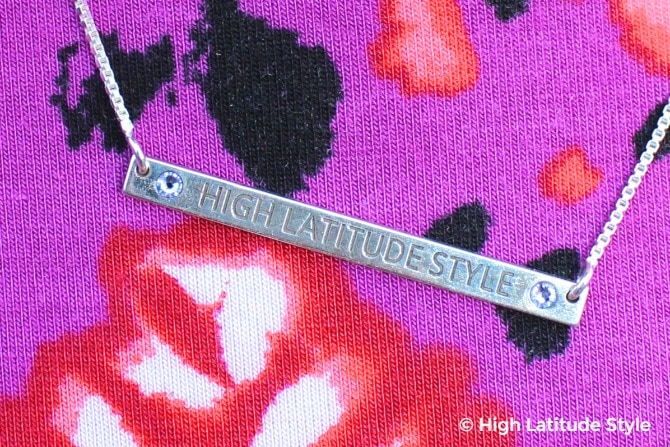 #accessories name plate with High Latitude Style engraved between two light blue gemstones