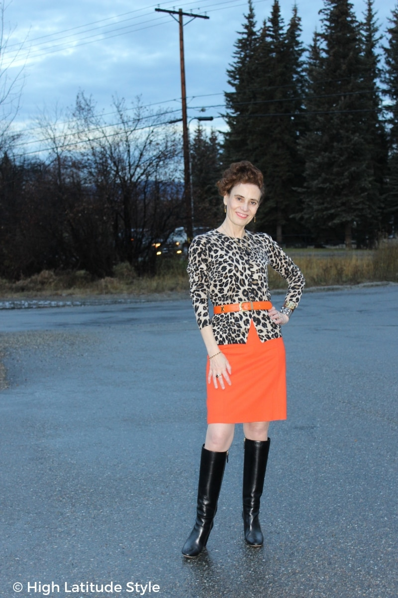 over 50 years old woman in leopard cardigan and orange skirt