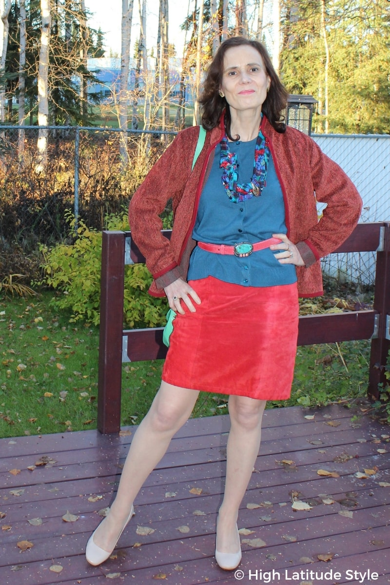 Nicole Mölders in a fall outfit in red and teal colors with mixed pattern and print