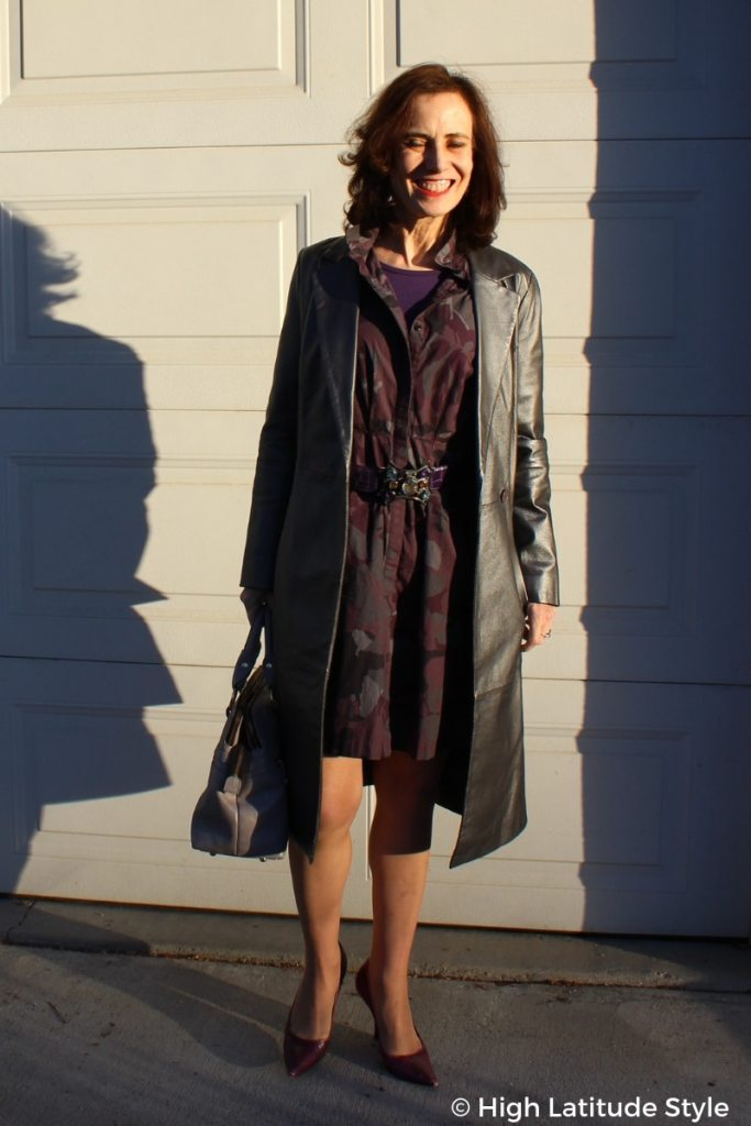 blogger in silver leather coat over shirtdress with belt