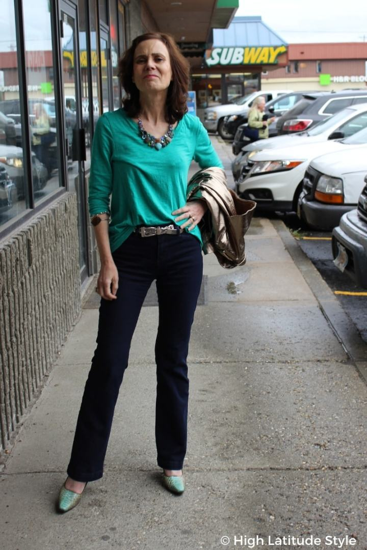 #styleover50 High Latitude Style in boot cut jeans, T-shirt, heels and statement necklace