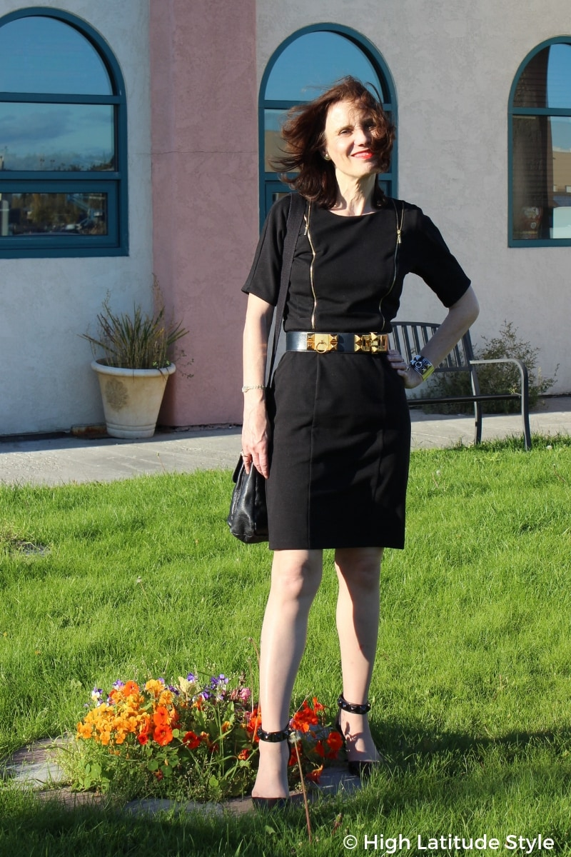 mature woman in LBD with studded belt and pumps