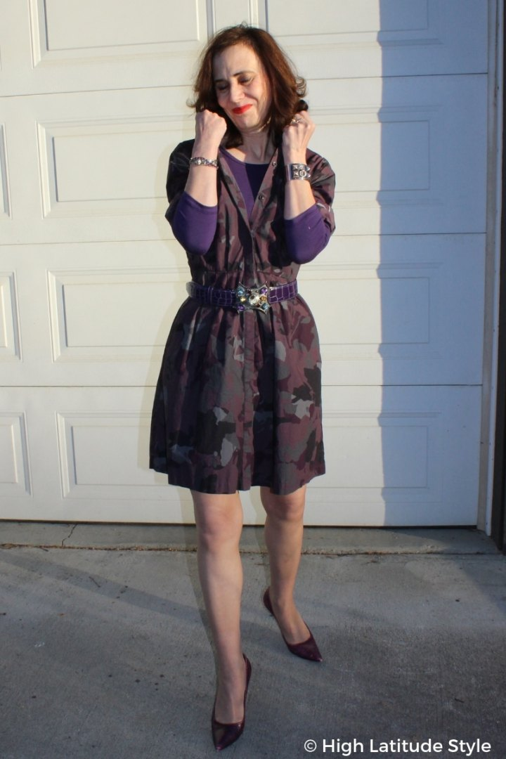 over 50 blogger Nicole in a printed belted dress with layering top and pointy toe heels
