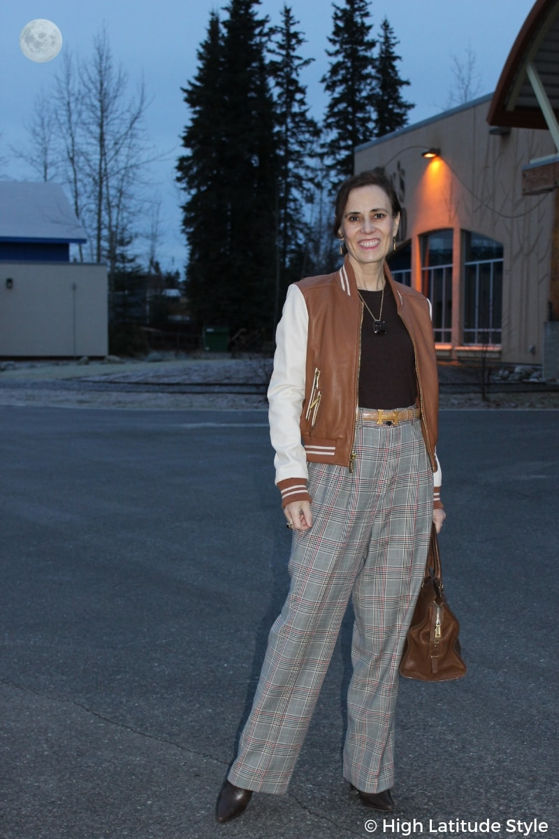 fashion blogger Nicole wearing wide plaid pants with a baseball jacket