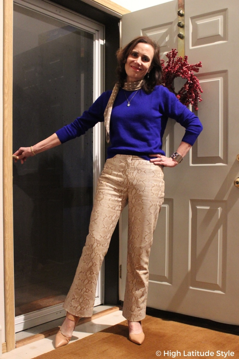 Blogger in trendy snake print, matching pumps and scarf, royal blue sweater