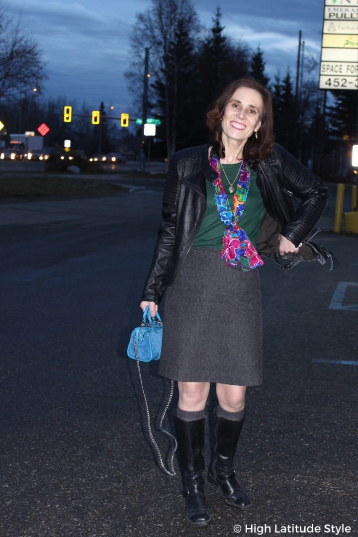 #chicover50 fashion blogger in tweed skirt, leather jacket, sweater, riding boots, scarf and shearling mini crossbody