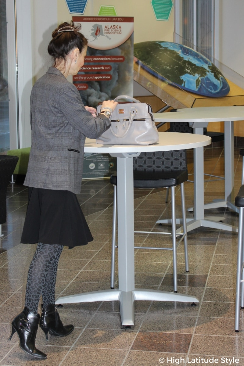 #chicover50 female scientist in meeting outfit with skirt, glen check blazer, briefcase