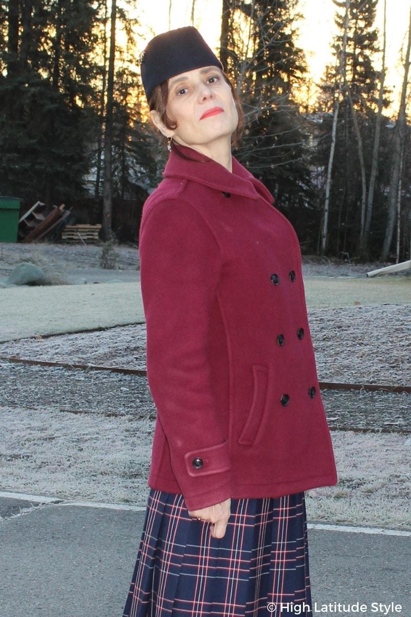 Alaskan blogger in pea coat over skirt and pill box hat