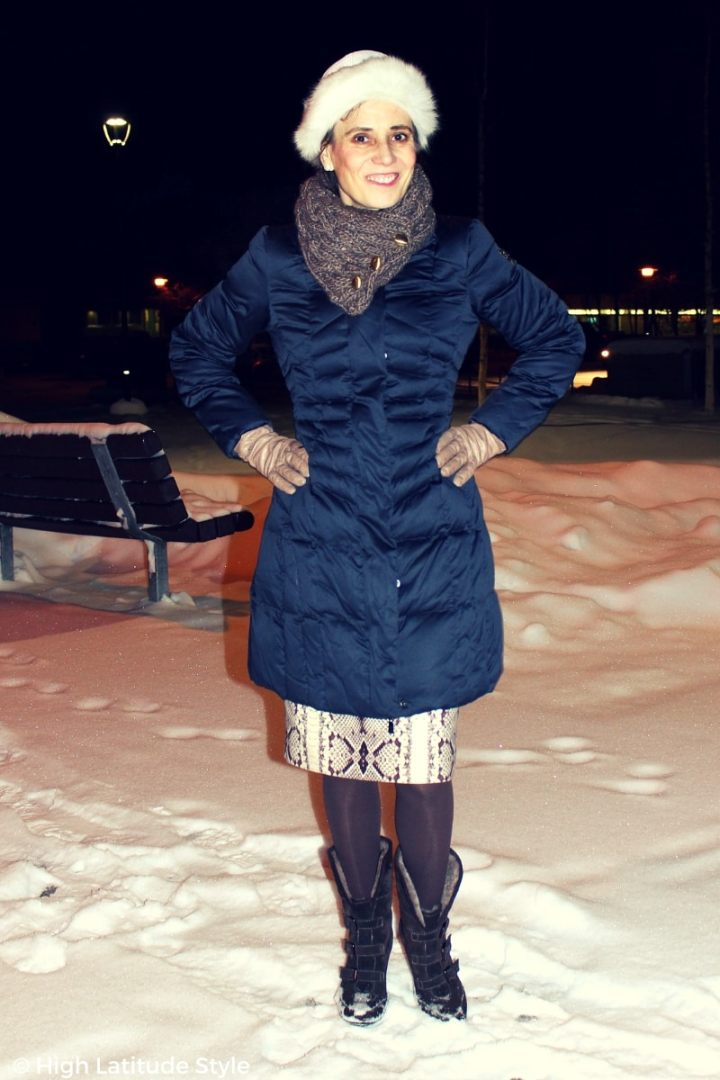 #agelessstyle fashion blogger in a sleek puffer garnment with skirt, hat, scarf, booties, and tight