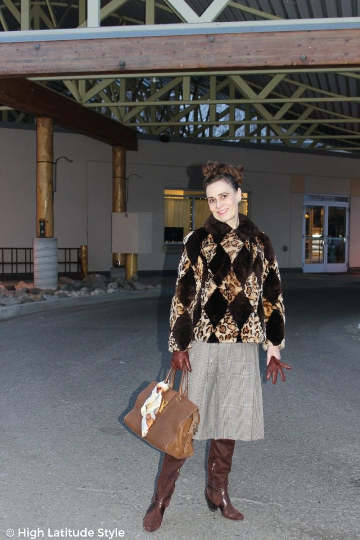 over 50 years old fashion blogger Nicole in winter outerwear suitable for going to work in tigh-high footwear