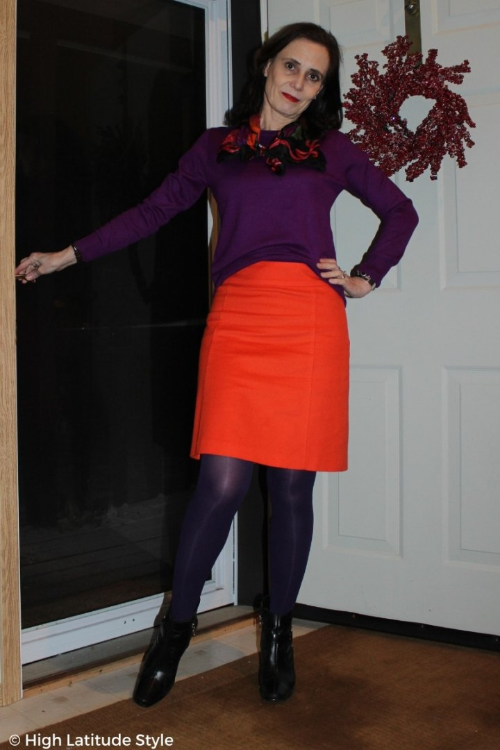 #over50fashion Nicole of High Latitude Style in purple and orange office look giving a glimpse thru the door