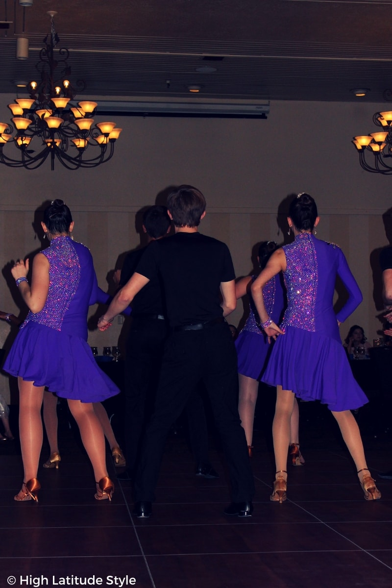 young dancers in trendy purple asymmetric costumes