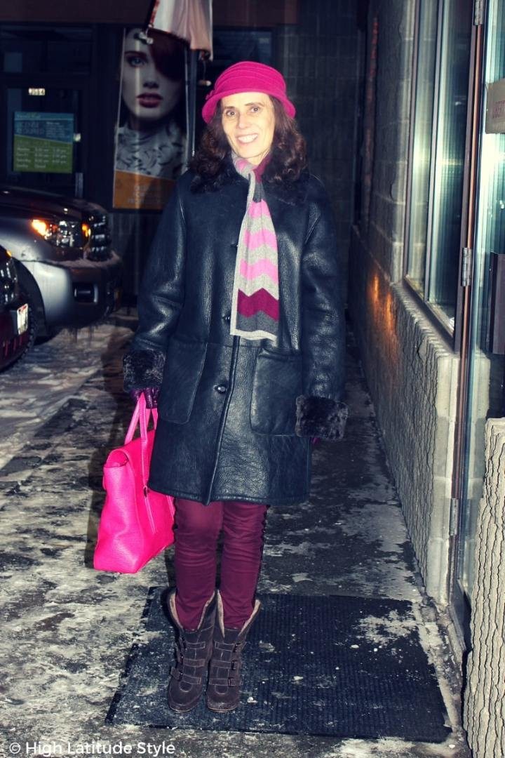 #advancedstyle older fashionista in casual winter look in gray, purple, pink