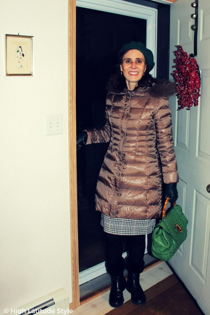 #fashionover50 style blogger in down coat, tights, plaid skirt with green beret, gloves and bag