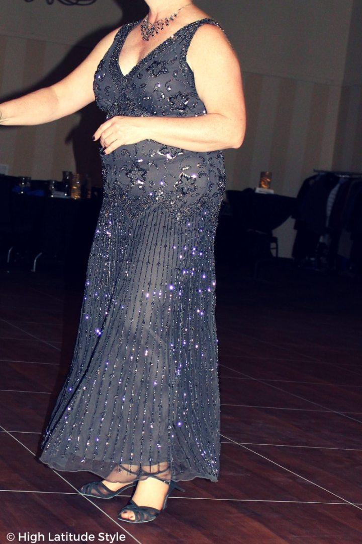mature woman wearing a flapper evening dress