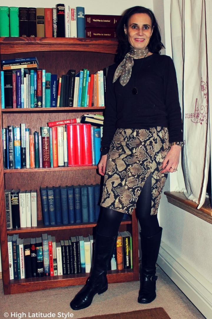 #trendsover50 fashion blogger donning the mixed print and snake print trends with black boots