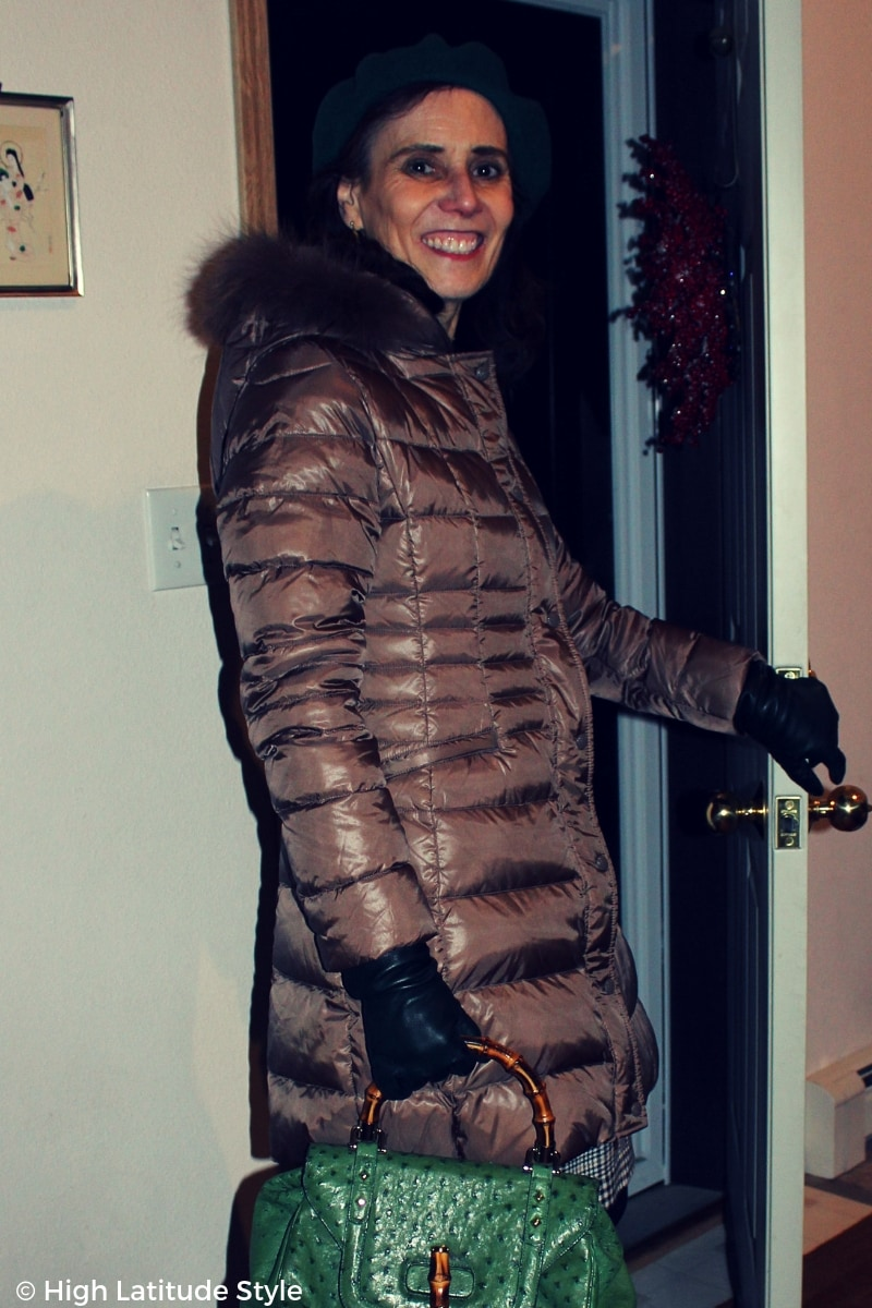 #advancedstyle fashion blogger in long tan puffer jacket with hoodie and green accessories